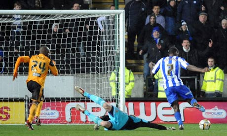 Michail Antonio, right, scores the third goal for Sheffield Wednesday against second-placed Hull