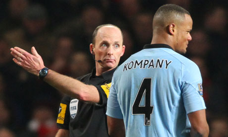 Manchester City's Vincent Kompany is given his marching orders from Mike Dean