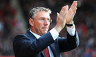 The former Southampton manager Nigel Adkins applauds fans