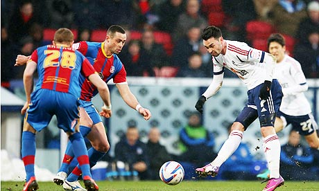 Bolton Wanderer's Chris Eagles, right, has a shot on goal against Crystal Palace