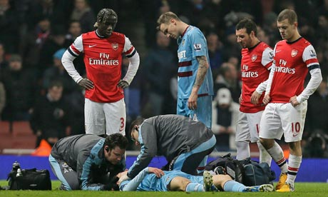 West Ham's Daniel Potts receives treatment during the match against Arsenal at the Emirates.