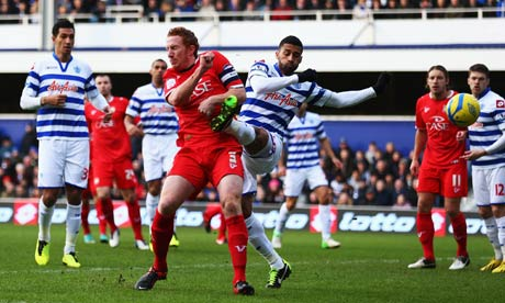 Armand Traoré, right, of Queens Park Rangers scores an own goal