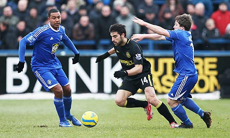Wigan Athletic's goalscorer Jordi Gomez, centre