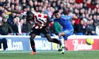 Brentford's Clayton Donaldson and Chelsea's Ashley Cole