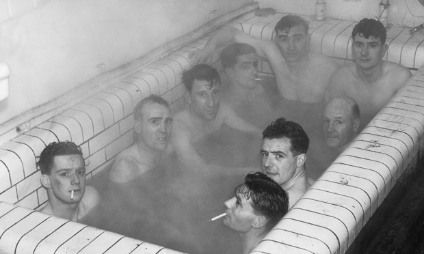 Ipswich Town football players having a bath after the replay of their third round FA Cup