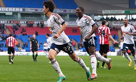 Bolton Wanderers's Lee Chung-Yong, left, celebrates