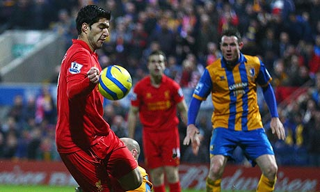 Liverpool's Luis Suárez handles the ball before scoring against Mansfield