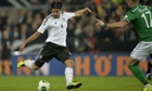 Germany's Sami Khedira scores the opening goal past Ireland's Damien Delaney, right, in Cologne.