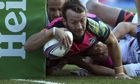 Gareth Davies of Cardiff dives over to score the winning try in the Heineken Cup game against Toulon