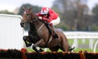 Sam Twiston-Davies on The New One clears the last at Kempton to win the William Hill.