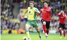 Norwich City's Jonny Howson, left, and Kim Bo-Kyung of Cardiff City in the Premier League