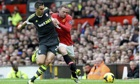 Manchester United's Wayne Rooney, right, and Stoke City's Geoff Cameron in the Premier League