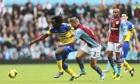 Everton's goalscorer Romelu Lukaku, left, and Aston Villa's Nathan Baker in the Premier League