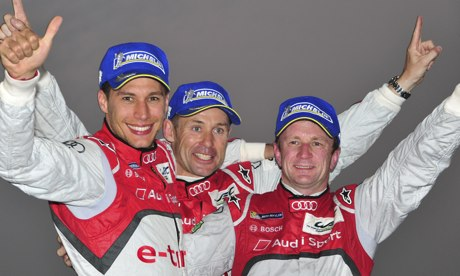 Allan McNish, right, celebrates his success with team-mates Ton Kristensen, left, and Loïc Duval.