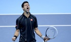 Novak Djokovic celebrates winning a point on his way to victory over Rafael Nadal at the O2 Arena.