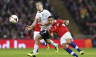 Jack Wilshere, left, and Alexis Sánchez compete for possession during England's friendly with Chile