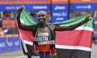 Geoffrey Mutai of Kenya celebrates his victory in the New York City Marathon.