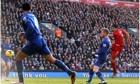 Liverpool's Luis Suarez scores the f
