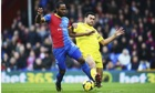 Crystal Palace's Cameron Jerome, left, and Steven Caulker of Cardiff City in the Premier League