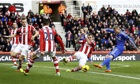 Chelsea's Andre Schurrle scores the opening goal at Stoke City in the Premier League
