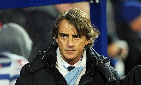 Roberto Mancini, the Manchester City manager, believes Manchester United's lead will be cut