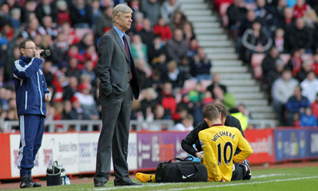 Jack Wilshere receives treatment Sunderland v Arsenal - Barclays Premier League
