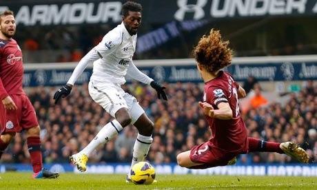 Emmanuel Adebayor of Tottenham tries to get round Newcastle's Fabricio Coloccini