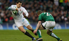 England's Alex Goode takes on Ireland's Keith Earls in Dublin.