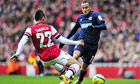 Blackburn Rovers' Martin Olsson, right, is tackled by Arsenal's Francis Coquelin in the FA Cup