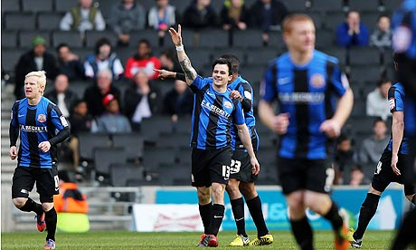 Barnsley's Chris Dagnall celebrates scoring the opening goal in the FA Cup against MK Dons