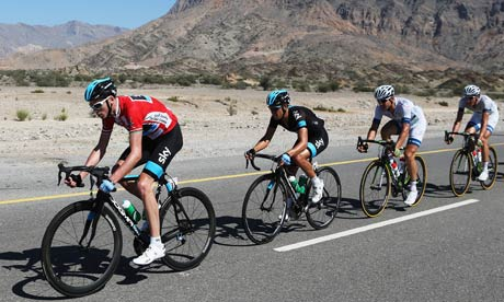 The Team Sky rider Chris Froome, left, rides in the peloton on the final stage of trhe Tour of Oman