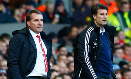 Michael Laudrup, right, said the esponsibility had to be shared between himself and the players