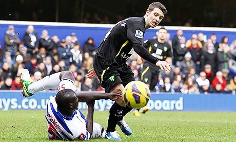 QPR's Chris Samba, left, and Norwich City's Wes Hoolahan