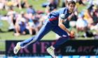 Steven Finn of England (R) bowls against