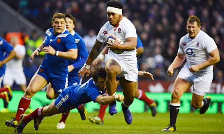 England's Manu Tuilagi against France