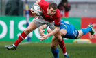 Wales's Dan Biggar is tackled by Italy's Andrea Masi.