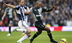 Tottenham's Jermain Defoe in action with West Brom's James Morrison