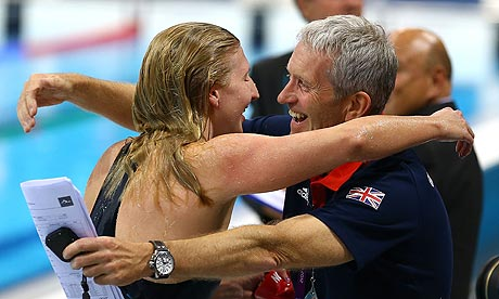 Rebecca Adlington of Great Britain hugs her coach Bill Furniss