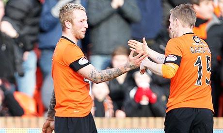 Dundee United's Johnny Russell, left, celebrates with fellow goalscorer Michael Gardyne
