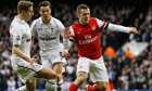 Arsenal's Jack Wilshere in action against Tottenham