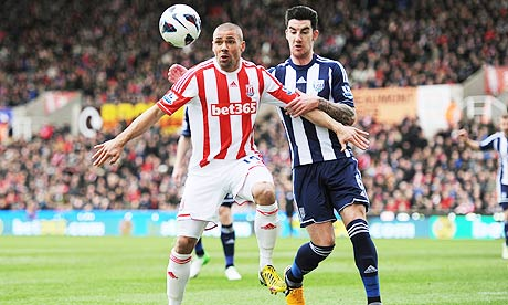 Stoke City's Jonathan Walters, left, and West Bromwich Albion's Liam Ridgewell in the Premier League