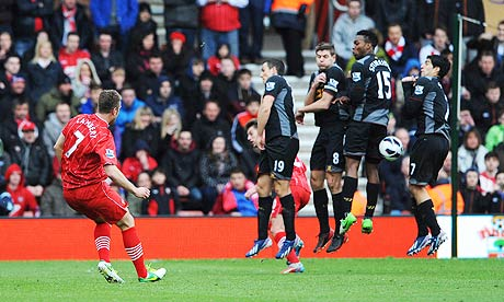 Southampton's Rickie Lambert, left, scores against Liverpool in the Premier League