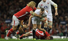 Wales hooker Richard Hibbard tackles Chris Ashton