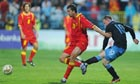 Wayne Rooney kicks Montenegro's Miodrag Dzudovic during the Euro 2012 qualifier