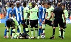 Massadio Haïdara of Newcastle United lies injured after being tackled by Wigan's Callum McManaman