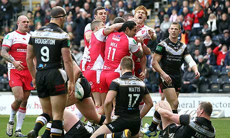 Hull Kingston Rovers players celebrate scoring against Hull FC