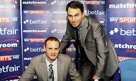 Eddie Hearn, right, poses with George Groves