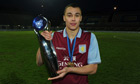 Graham Burke, who converted two penalties for Aston Villa, holds the NextGen Series trophy aloft