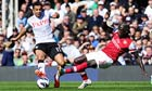 Kieran Richardson of Fulham is tackled by Bacary Sagna of Arsenal