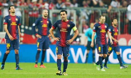 Barcelona's Xavi, centre, and team-mates look dejected after Bayern